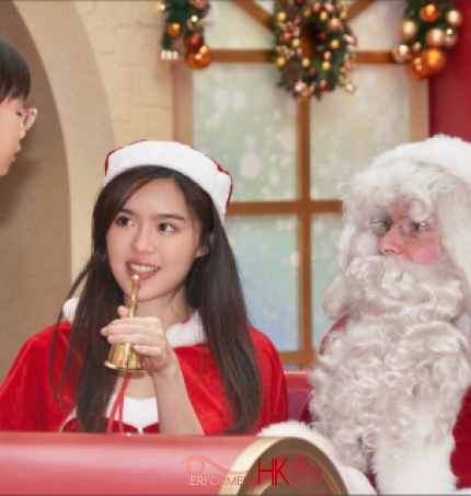 young girl at a mall in hk approaching santa for a chat