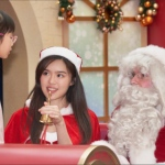 santa interacting with young girl