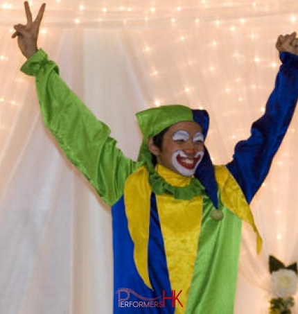 Hong Kong walk around clown juggler holding his both hands up at an event