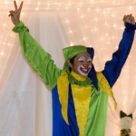 Anson in his yellow , blue and green clown costume.