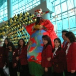 Giant choi sun with guests at Hong Kong International Airport.