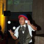 Clown in Hong Kong juggling 3 balls at a corporate event