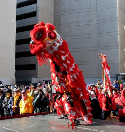 Hong Kong Dancer performing Lion Dance with the Red Lion on the street for a Chinese new year corporate event