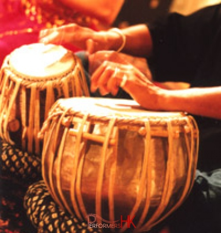 Traditional ethnic instrument player in Hong Kong playing Tabla at a corporate event
