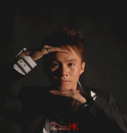 Hong Kong Magician head shot holding his hands in front of his forehead and chin