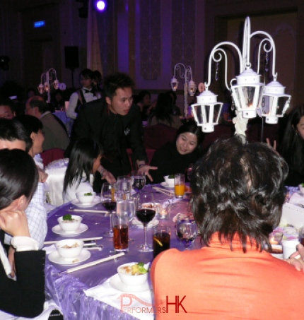 Hong Kong walk around magician performing table magic at corporate annual dinner