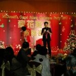 Andy doing a stage magic show for Mcdonalds Grand Palace Christmas party.