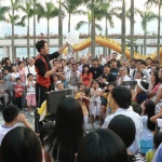 Street Magic at Tsim Sha Tsui attracting a large crowd.