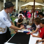 Magician Andy entertaining children at Repulse Bay.