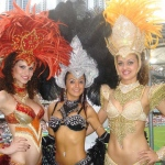Three exotic Samba dancers posing in their gorgeous costumes at Hong Kong Rugby Sevens.