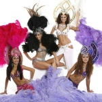 Fantastic large head-dress and fluffy feathers with beautiful Samba dancers