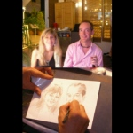 Caricaturist drawing two people at a corporate event